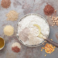 Gluten free baking overhead view of bowl with flour and grains next to bowl on table Stock Photo
