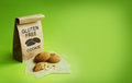 Gluten-free cookies in the kraft bag. Green background Royalty Free Stock Photo