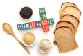 Gluten free letter blocks surrounded with products including wild rice and oats Stock Image
