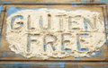 Gluten free words in flour written coconut on a wooden board Royalty Free Stock Photo