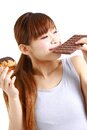 Gluttonous woman concept shot of young womans life style Royalty Free Stock Photography
