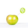 Gmo free green apple with a sign on white table isolated on white background closeup studio shot copy space available Royalty Free Stock Photos