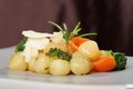 Gnocchi di patata italian potato noodle with brocolli and tomatoes Stock Image
