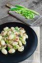 Gnocchi pasta with ham, spring onion
