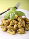 Gnocchi and pesto sauce Royalty Free Stock Photo