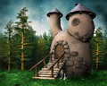 Gnome cottage in a green forest Royalty Free Stock Photo