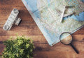 Go on an adventure the map and the camera a wooden table top view Royalty Free Stock Photo