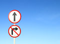 Go ahead the way forward sign and don t turn right sign with blue sky blank for text Royalty Free Stock Images