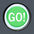 Go car start green button word move forward the on a to illustrate acceleration and movement toward a goal or to speed up for a Stock Images