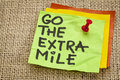 Go the extra mile reminder motivational handwriting on sticky note Royalty Free Stock Photography