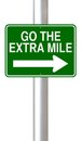 Go the extra mile a road sign indicating Stock Photography