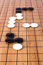 Go game close up view of black and white stone pieces on chinese board Royalty Free Stock Images