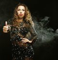 Go go dancer in black dress over smoke background Stock Image
