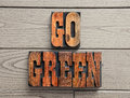 Go green background word antique wooden letterpress blocks Royalty Free Stock Images