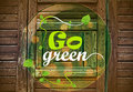 Go green message on wooden background Stock Images