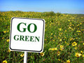 Go green sign field of flowers Royalty Free Stock Photography