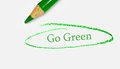 Go green text circled by pencil Royalty Free Stock Photography