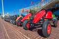 Go karts durban beach promenade pedal for children to have fun photo wide angle image of close up of toys for hire on beachfront Royalty Free Stock Image