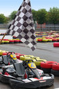 Go karts and race flag Royalty Free Stock Photo