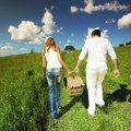 Go on picnic man and women walk in green grass Stock Photo