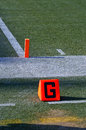 Goal line close up shot of and end zone pylon Stock Photos