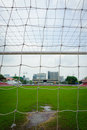 Goal net at soccer yard with grass Royalty Free Stock Photography