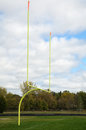 Goal posts on american football field yellow Stock Photos