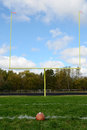Goal posts on american football field yellow and Stock Photos
