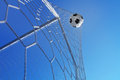 Goal. Soccer ball in net on blue sky background. Stock Image