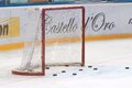 Goalie gate and hockey pucks Royalty Free Stock Photo