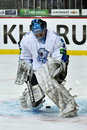 Goalie Vitaly Yeremeyev misses the puck between the legs Stock Images