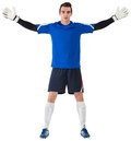 Goalkeeper in blue ready to save on white background Royalty Free Stock Image