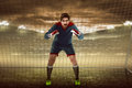 Goalkeeper in front of goalpost image Stock Images