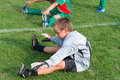 Goalkeeper kids football do stretching before match Royalty Free Stock Photo