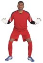 Goalkeeper in red ready to save on white background Royalty Free Stock Photos