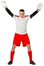 Goalkeeper in red and white ready to catch on background Royalty Free Stock Image