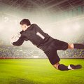 Goalkeeper soccer or football is catching ball on stadium warm colors toned Stock Photos