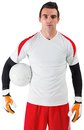 Goalkeeper standing in white jersey on background Stock Photography