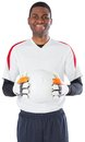 Goalkeeper in white holding ball on background Stock Photos