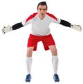 Goalkeeper in white ready to save on background Stock Photography