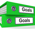Goals folders show direction aspirations and targets showing Royalty Free Stock Images