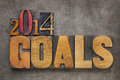 Goals in wood type new year resolution concept text vintage letterpress blocks against grunge metal Royalty Free Stock Images