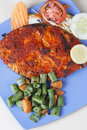 Goan pomfret fry a dish from goa in western india made of fish and spices Royalty Free Stock Photo