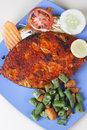 Goan pomfret fry a dish from goa in western india made of fish and spices Royalty Free Stock Photography