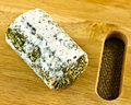 Goats cheese a closeup of mature covered in herbs and mold Royalty Free Stock Images