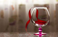 Goblet glass red ribbon objects still life thanksgiving marble reflection Royalty Free Stock Photos