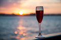 Goblet with red wine on sea background Royalty Free Stock Photos