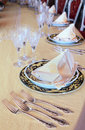 Goblets, forks and plates with placemat Royalty Free Stock Image