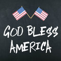 God bless america note with american flags Royalty Free Stock Photography