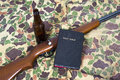 God guns and guts abstract background concept for the scene uses metaphors with a gun rifle weapon the holy bible a beer bottle Royalty Free Stock Image
